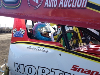 Amber Balcaen getting strapped in. Photo By: Rick Rea - River Cities Speedway