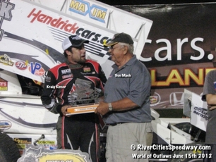 Don Mack presenting Kraig Kinser with trophy at The Bullring River Cities Speedway