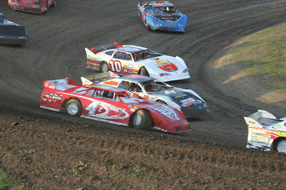 NLRA Late Models race side by side on the high banked track at River Cities Speedway