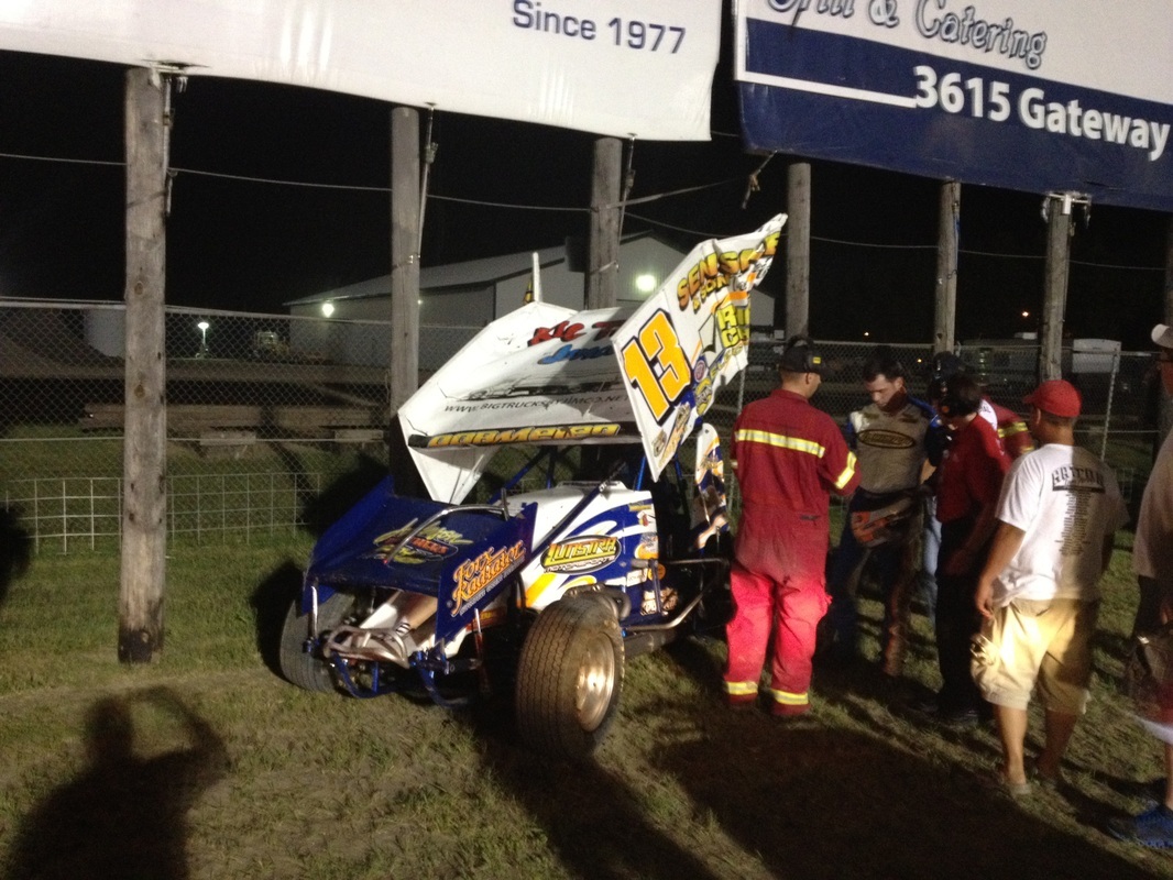 Mark Dobmeier took a tumble off the high bank track - River Cities Speedway